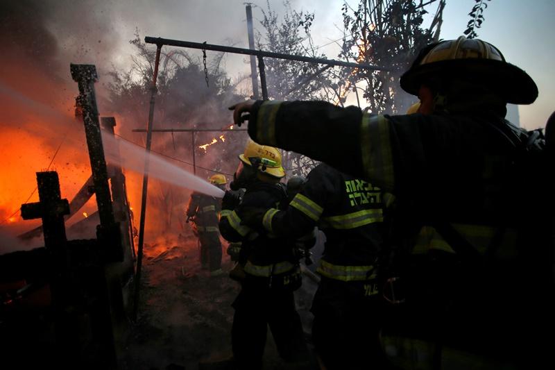 כמה מקבלים לוחמי האש שסיכנו חייהם בחיפה?