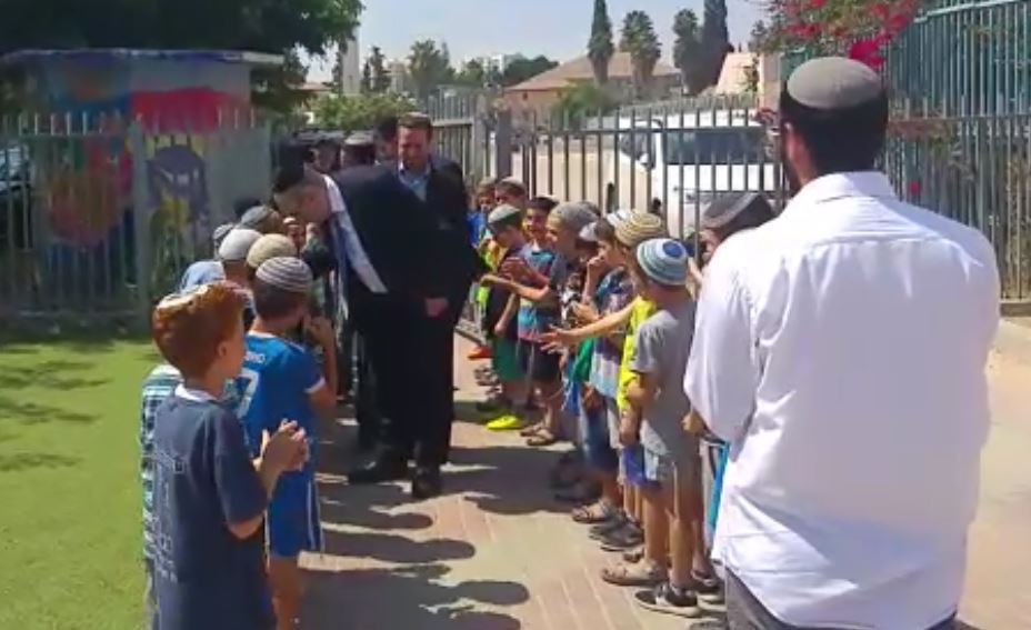 Dati children warmly welcome Yakov Asher